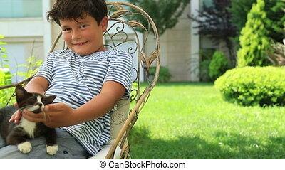 Little boy hugging his pet cat - Happy little boy loves his...
