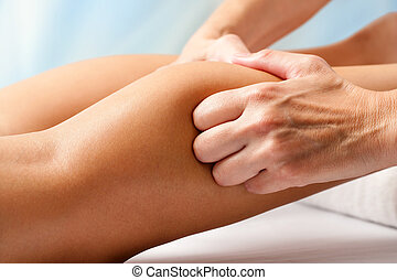 Physiotherapist hands massaging calf muscle - Macro close up...