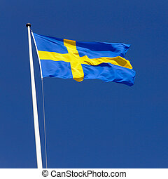Swedish flag flies sunlit in the fresh wind on a flagpole...