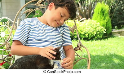 Little boy hugging his pet cat - Happy little boy loves his...