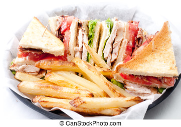 clubhouse sandwich with crispy fries - clubhouse sandwich on...