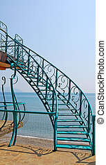 Stairs, sea and sky - The image of the green steel stairs,...