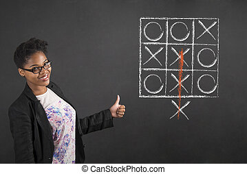 African woman with thumbs up hand signal with tic tac toe on...