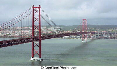 Traffic on the 25 de Abril Bridge in Lisbon, Portugal.