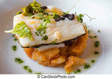 baked cod on a bed of potatoes