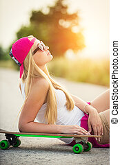 Attractive hipster teenage girl with skateboard, image with...