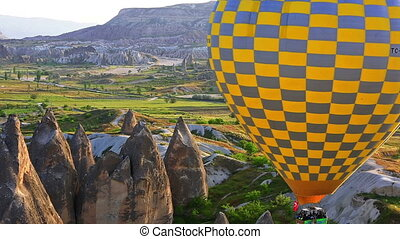 Passenger balloons floating over Cappadocia, Turkey -...