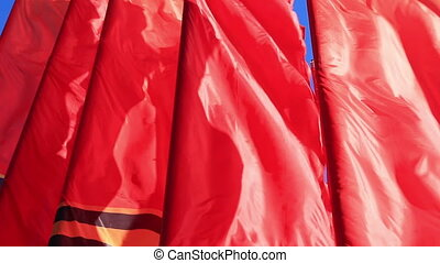Decorative red flags waving in wind - Decorative scarlet...