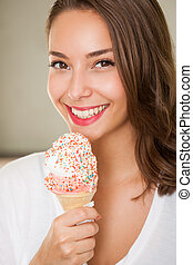 Ice ream cutie - Beautiful young brunette woman having...