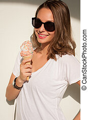 Ice ream cutie. - Beautiful young brunette woman having...
