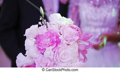 Cutting wedding cake - Couple newlyweds cut beautiful...