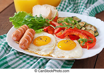 English breakfast - fried eggs, sausages, zucchini and sweet...