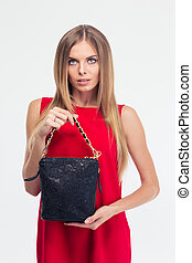 Portrait of a fashion woman in red dress holding bag