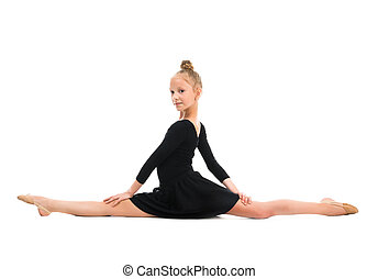 little gymnast stretching on the floor isolated on white...