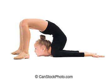 little gymnast doing stretching exercise on the floor...