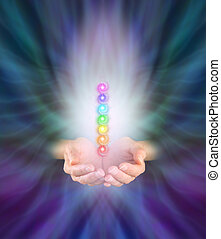Chakra Healer - Healer's hands emerging from feather like...