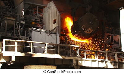 Bucket with hot metal - Hot steel pouring in steel plant