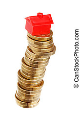 Stacked coins vith red house