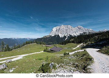 alpine chalet at fall with wetterstein mountain in tyrol