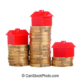 House prices - Red small house on top of stacks of coins...
