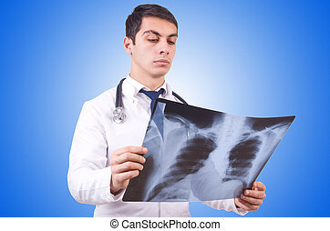 Young doctor with x-ray image on white