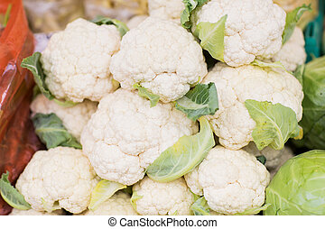 close up of cauliflower at street market - sale, harvest,...