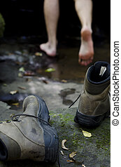 Back to nature concept - Worn out hiking boots laying on a...