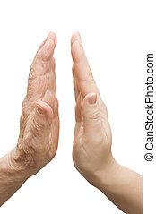 Hands of young woman and elderly man