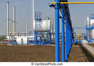 Fuel Tanks - White fuel tanks in natural gas treatment plant...
