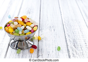 Jelly Beans - Heap of colorfull Jelly Beans on bright wooden...