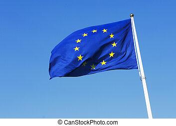 European Union Flag - European Union flag waving on blue...