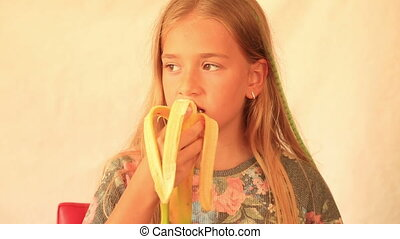 Cute girl eating banana