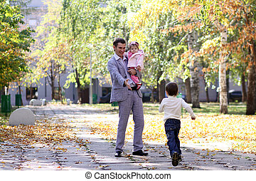 Autumn - family in autumn park