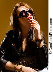 Elegant surprized young woman in black leather jacket loking...