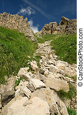 uphill stony path - stony ground in the middle of the...