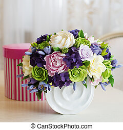 Rose flower bouquet and gift box on wooden table