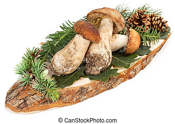 ceps and green leaves on cutting board - three ceps and...