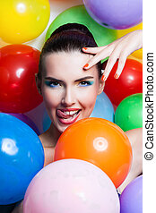 Beauty Girl Portrait with Colorful Makeup, Nail polish and Accessories. Colourful Studio Shot of Funny Woman. Vivid Colors.