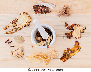 Alternative Medicinal , Chinese herbal medicine  for healthy recipe with dry herbs  and mortar on wooden background.
