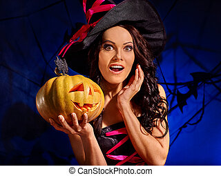 Witch holding pumpkin - Happy witch holding big orange...