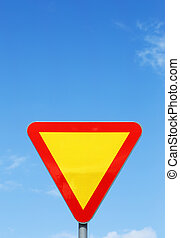Give way - Swedish traffic sign Give Way on blue sky.