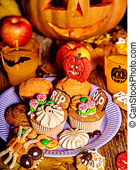 Halloween table with trick or treat Carving pumpkin