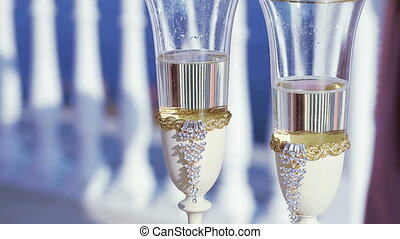 Pillow for rings - On table, pillow rings and champagne at...