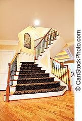 Staircase in Upscale Home - Low angle view of staircase and...