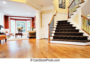 Entryway in Upscale Home - Open entryway with wood floor and...