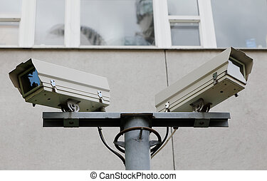 Security cameras - Close-up of two security cameras monted...