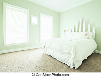 Pastel Bedroom Interior - View of a simple upscale bedroom,...