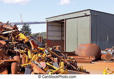 Junk yard - Junk jard with a shed and a pile of metal scrap