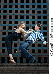 Young couple dancing the tango.