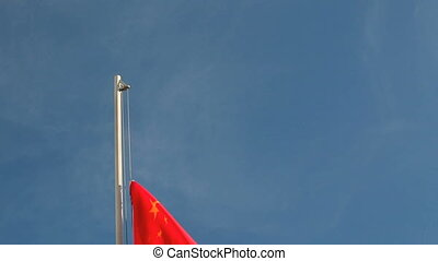 Hoist China flag in front of blue sky